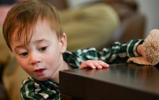 Joshua Johnson explores his living room Thursday, Nov. 21, 2019, in Sauk Rapids.