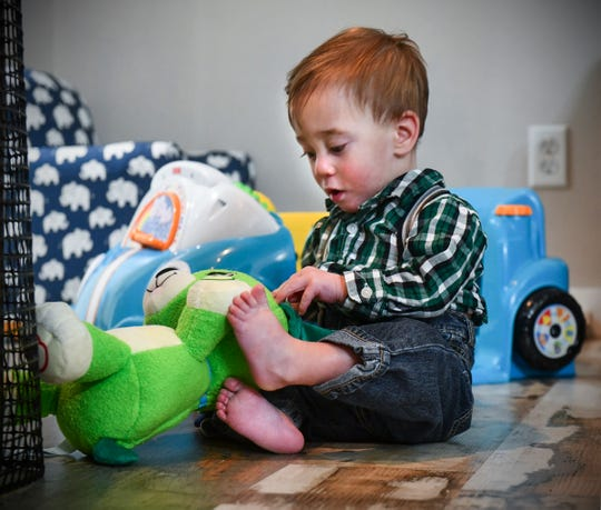 Joshua Johnson plays with toys Thursday, Nov. 21, 2019, at his home in Sauk Rapids.