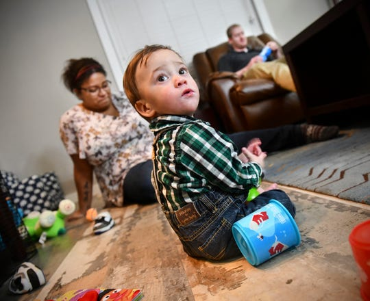 Joshua Johnson plays on the floor near his parents Vicki and Christopher  Thursday, Nov. 21, 2019, at their home in Sauk Rapids. Joshua was born in Sept. 2018, more than three months early at 1 pound 14 ounces.