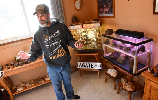 Lyndon Johnson talks about agates and rare minerals that he has discovered in Minnesota Friday, Nov. 22, 2019, at his home in Sauk Rapids.