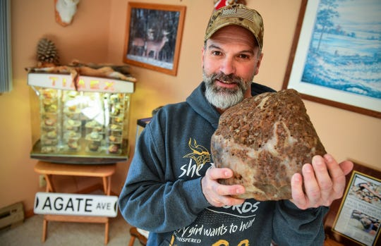Lyndon Johnson holds one of his larger agates of more than 30 pounds Friday, Nov. 22, 2019, at his home in Sauk Rapids. Johnson has been finding, collecting and sharing his knowledge on locate agates and rare minerals for decades.