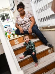 Vicki Johnson watches as her son Joshua tries climbing down the stairs Thursday, Nov. 21, 2019, at their home in Sauk Rapids.