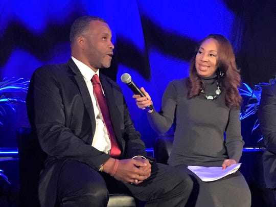 Tiffany Greene interviews Bethune-Cookman head coach Terry Sims during the Florida Classic Consortium Kickoff Luncheon in Orlando on Friday, Nov. 22, 2019.