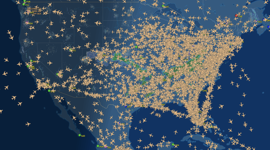 A screenshot of the live flight tracking map at Flight Aware. The day before Thanksgiving is the busiest travel day of the year.