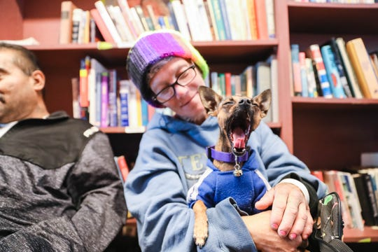 Kimberly Atencio and her dog Lucky visit the Mesilla Valley Community of Hope to get birth certificates, driver's licenses and job help in Las Cruces on Friday, Nov. 22, 2019.