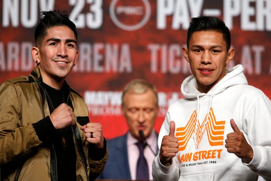 Boxers Leo Santa Cruz and Miguel Flores pose during a news conference at MGM Grand Garden Arena in Las Vegas on Wednesday, Nov. 20, 2019. The boxers will meet in a super featherweight fight at the arena on Saturday, Nov. 23, 2019.