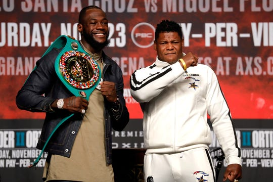 WBC heavyweight champion Deontay Wilder, left, and Luis Ortiz pose during a final news conference at MGM Grand Garden Arena in Las Vegas on Wednesday, Nov. 20, 2019. The boxers will have a rematch at the arena on Saturday, Nov. 23, 2019.