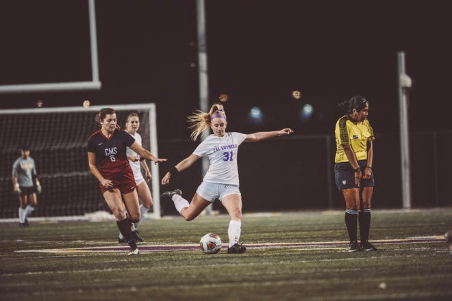 Cal Lutheran University midfielder Kylie Garcia, a freshman from Ventura High, delivers a ball against Claremont-Mudd-Scripps in the second round of the NCAA Division III tournament on Sunday at Rolland Stadium.