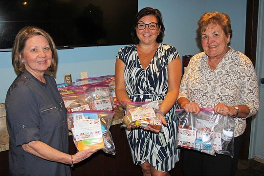 (From left) Zonta Club of Cumberland County members Nellie D'Alessandro and Lori DeMatte, and Betsy Perugini, vice president, are pictured with 35 welcome bags of gift items for breast cancer patients, which club members recently assembled and donated to Penn Medicine Virtua Cancer Center in Voorhees. Zonta is an international service organization of women in business and the professions who are dedicated to improving the status of women worldwide.For information about Zonta, visit Zonta.org, or for local membership information, call (856) 825-7733.