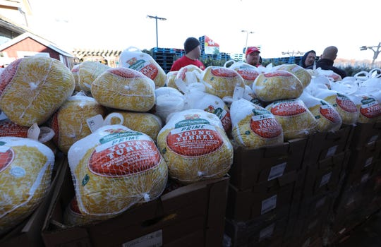 """Frozen turkeys wait for distribution during a Thanksgiving turkey giveaway for needy families at the Stew Leonard's store in Yonkers, Nov. 21, 2019. Over 500 turkeys were handed out, via a """"turkey brigade"""" assembly line with Yonkers city officials, firefighters, police and other first responders."""