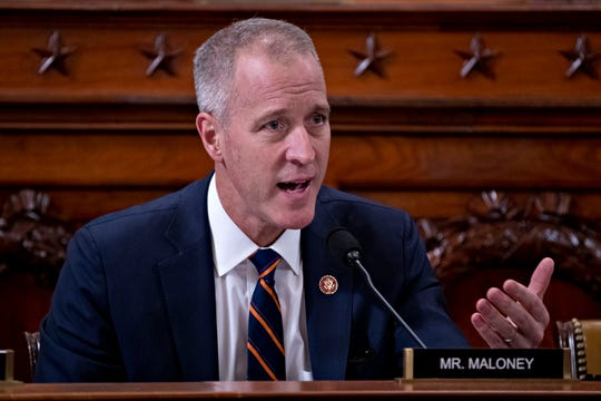 Rep. Sean Patrick Maloney, D-N.Y., questions former White House national security aide Fiona Hill, and David Holmes, a U.S. diplomat in Ukraine, as they testify before the House Intelligence Committee on Capitol Hill in Washington, Thursday, Nov. 21, 2019, during a public impeachment hearing of President Donald Trump's efforts to tie U.S. aid for Ukraine to investigations of his political opponents.