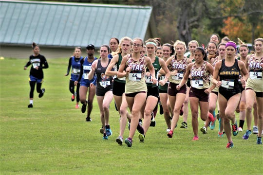 STAC'S Abby Kimbrell leads pack during 2018 cross-country race.