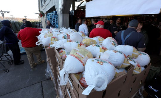 "Frozen turkeys wait for distribution during a Thanksgiving turkey giveaway for needy families at the Stew Leonard's store in Yonkers, Nov. 21, 2019. Over 500 turkeys were handed out, via a ""turkey brigade"" assembly line with Yonkers city officials, firefighters, police and other first responders."