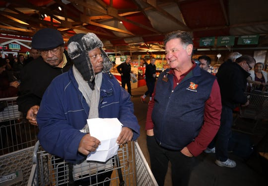 """Stew Leonard Jr, right, chats with Ken Davis from the Luther V. Garrison Masonic Lodge, during a Thanksgiving turkey giveaway for needy families at the Stew Leonard's store in Yonkers, Nov. 21, 2019. Over 500 turkeys were handed out, via a """"turkey brigade"""" assembly line with Yonkers city officials, firefighters, police and other first responders. In addition a turkey named, """"Mooney"""" after recently retired William Mooney Jr., the former President and CEO of the Westchester County Association, was """"pardoned""""."""