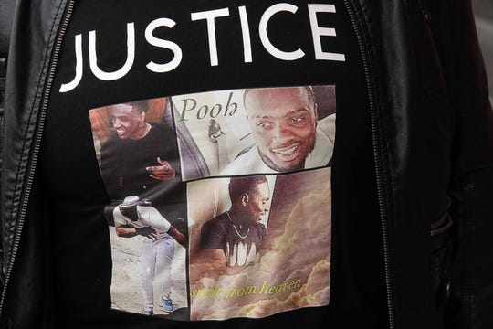 Family and friends of murder victim David Bailey wore t-shirts with pictures of Bailey on them to make a statement to the judge sentencing his killer on Friday morning at the New Castle County Courthouse.