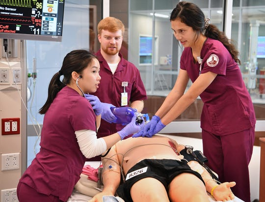 "MSU Texas nursing students treat a ""patient"" involved in a serious cycling accident during an Interdisciplinary Communications Event Nov. 22, 2019, at Centennial Hall."