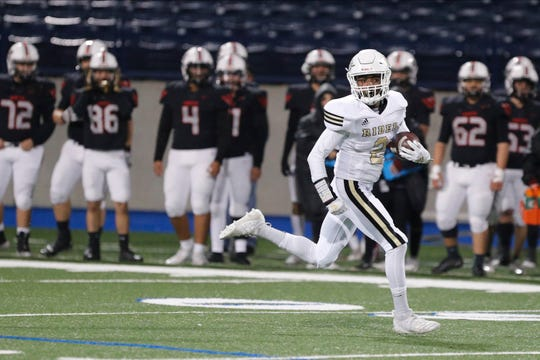 RiderÕs Nick Darcus puts distance between himself and the El Paso Hanks defense on a big run in the Region I-5A Division II area-round playoff game November 21, 2019 at Grande Communications Stadium in Midland.