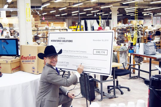Wearing his newly minted American Hat black felt Julian Alvarez, Texas Workforce Commissioner for Labor signed a grant check for North Central Texas College and American Hat Monday during ceremonies at the Bowie manufacturing plant. The company and college received a $98,174 job skills grant going for new and existing workers.
