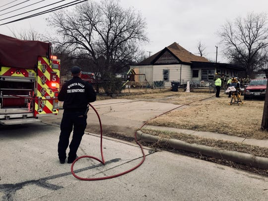 Wichita Falls fire and police respond to a house fire Friday afternoon on Ninth Street. A woman and animal were found deceased in the house.