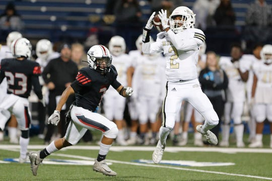 Rider's Nick Darcus (2) makes a reception against El Paso Hanks' Adam Villalobos (7) in the Region I-5A Division II area-round playoff game November 21, 2019 at Grande Communications Stadium in Midland. Photo credit : James Durbin