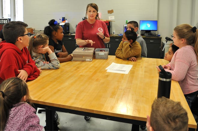 Wichita Falls Independent School District S.T.E.A.M instructor, Julie Yandell works with a small group of Ben Milam students Friday afternoon at their newly remodeled learning center located at the Carrigan Center.