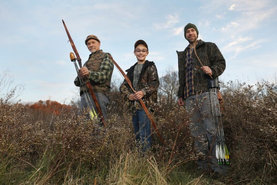 John Beardsley, his grandson Jensen and son Matt love to hunt deer, most of the time with bows, and often with bows and arrows made by Matt or John.