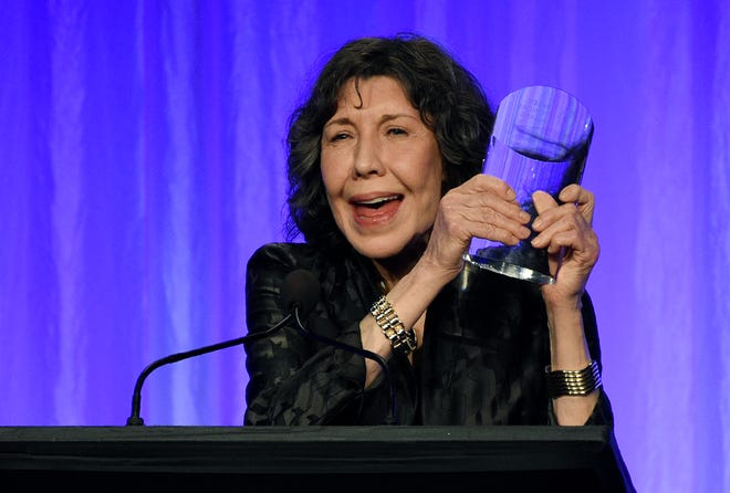 """Honoree Lily Tomlin holds her award onstage at """"The Paley Honors: A Special Tribute to Television's Comedy Legends"""" at the Beverly Wilshire Hotel, Thursday, Nov. 21, 2019, in Beverly Hills, Calif. (Photo by Chris Pizzello/Invision/AP) ORG XMIT: CACP129"""