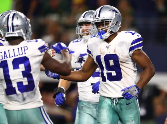 Dallas Cowboys receiver Amari Cooper (19) celebrates his fourth quarter touchdown against the Green Bay Packers at AT&T Stadium.