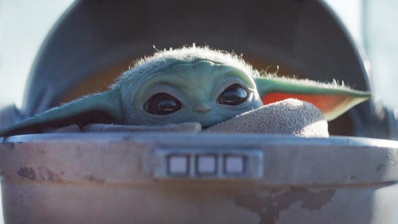 Baby Yoda in The Mandalorian, available to stream on Disney+