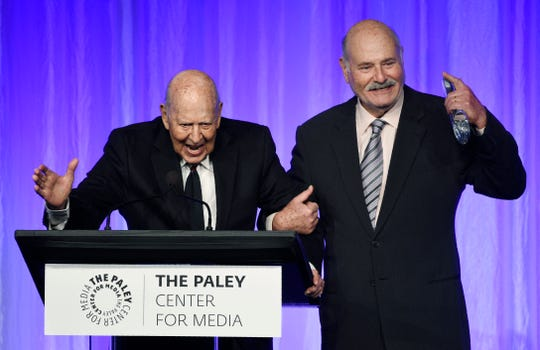 """Honoree Carl Reiner, left, is joined by his son Rob Reiner as he accepts his award at """"The Paley Honors: A Special Tribute to Television's Comedy Legends"""" at the Beverly Wilshire Hotel, Thursday, Nov. 21, 2019, in Beverly Hills, Calif. (Photo by Chris Pizzello/Invision/AP) ORG XMIT: CACP136"""