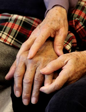 A caregiver and her husband, who is an Alzheimer's patient, at their home in San Francisco, California, in September 2011.
