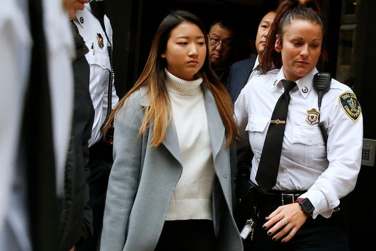 "Inyoung You leaves Suffolk Superior Court in Boston, Friday, Nov. 22, 2019 after pleading not guilty to involuntary manslaughter. Prosecutors say You sent Alexander Urtula more than 47,000 text messages in the last two months of their relationship, including many urging him to ""go kill yourself."""