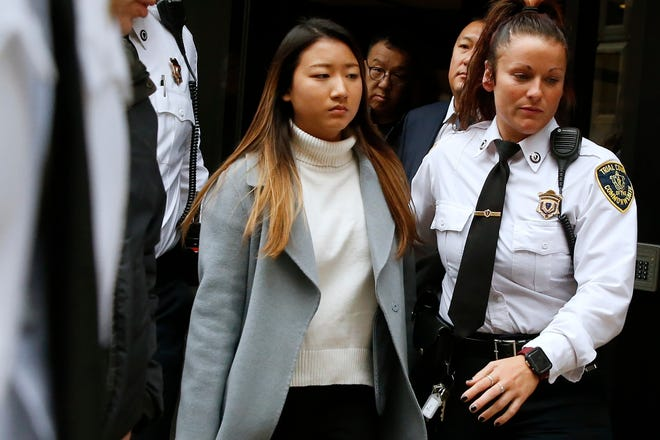 """Inyoung You leaves Suffolk Superior Court in Boston, Friday, Nov. 22, 2019 after pleading not guilty to involuntary manslaughter. Prosecutors say You sent Alexander Urtula more than 47,000 text messages in the last two months of their relationship, including many urging him to """"go kill yourself."""""""