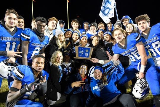 Hammonton celebrates after their 28-12 win over visiting Jackson Memorial in the NJSIAA Central Group IV championship game on Friday, Nov. 22, 2019.