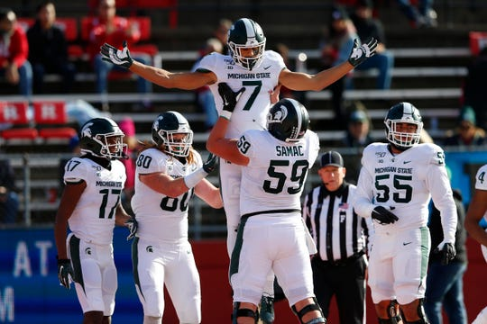 Michigan State Spartans wide receiver Cody White (7) celebrates with teammates after scoring a touchdown against the Rutgers Scarlet Knights during the first half at SHI Stadium.