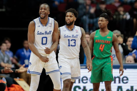Seton Hall Pirates guard Quincy McKnight (0) reacts after scoring a basket in front of guard Myles Powell (13) and Florida A&M Rattlers guard Rod Melton Jr. (4)