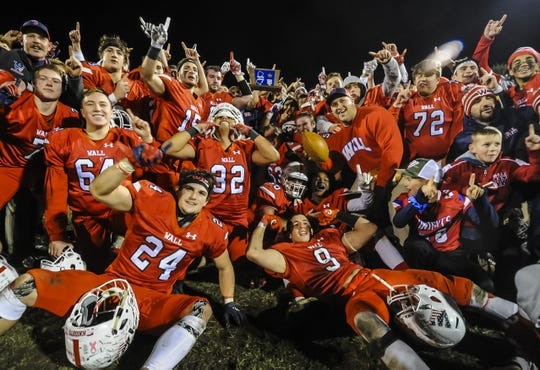 Wall celebrates with the NJSIAA trophy after their 14-13 win over Rumson Fair Haven in the NJSIAA Central Group III championship game in Wall on Nov.22, 2019.
