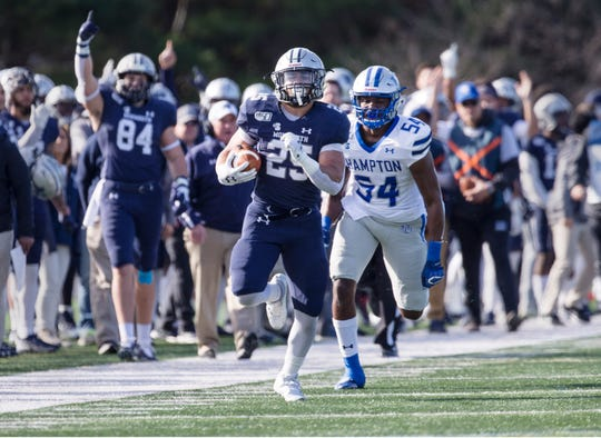 Hampton at Monmouth football. Monmouth's Pete Guerriero gains yards on the ground. West Long Branch, NJSaturday, November 23, 2019
