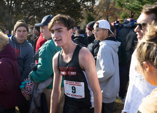A tired Liam Murphy cools down after winning the boys race at NJSIAA Boys Cross Country Meet of Champions at Holmdel Park, Holmdel, NJ on November 23, 2019.