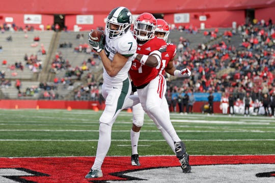 Michigan State wide receiver Cody White (7) catches a touchdown pass in front of Rutgers defensive back Tim Barrow during the first half of an NCAA college football game Saturday, Nov. 23, 2019, in Piscataway, N.J.