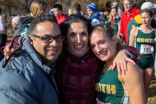 Joe and Elena Gonzalez with daughter Chloe who won the girls race. NJSIAA Girls Cross Country Meet of Champions at Holmdel Park, Holmdel, NJ on November 23, 2019.