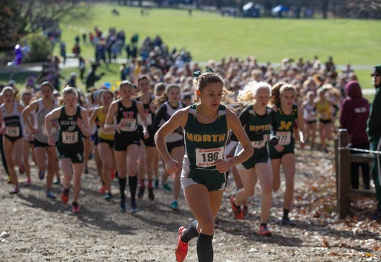 North Hunterdon's Chloe Gonzalez leads the pack up the hill at the start of the NJSIAA Cross Country Meet of Champions on Saturday, Nov. 23, 2019.