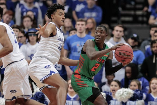 Florida A&M Rattlers guard Kamron Reaves (2) looks to pass as Seton Hall Pirates guard Jared Rhoden (14) defends.