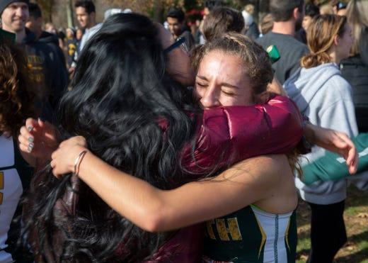 Girls winner Chloe Gonzalez gets a hug from her mom Elena. NJSIAA Girls Cross Country Meet of Champions at Holmdel Park, Holmdel, NJ on November 23, 2019.