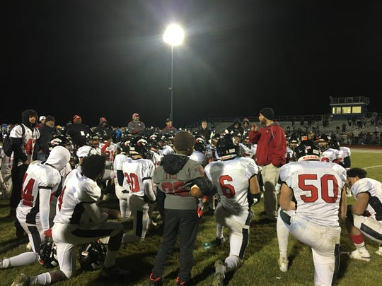 Jackson Memorial football coach Vin Mistretta speaks with his team following Friday's sectional final loss to Hammonton
