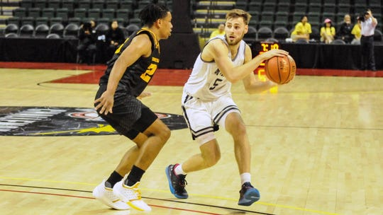 Monmouth guard George Papas looks to pass against Kennesaw State int he Hawks' 71-40 win at the MAAC/ASun Challenge in Orlando, Florida on Nov. 22, 2109.