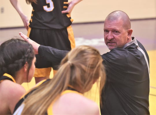 Seminole coach Tri Danley talks to his team during a timeout in the Maidens' game against Wylie. Wylie won the game 49-35 to finish third in the Polk-Key City Classic.