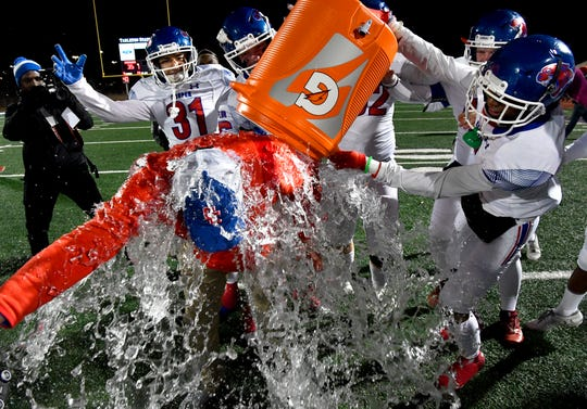 Cooper High School head coach Aaron Roan gets the Gatorade Bath as the clock runs out on Friday's playoff game between the Cougars and Azle Nov. 22, 2019. Final score was 35-28, Cooper.