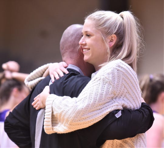 Wylie assistant coach Peyton Little hugs Seminole coach Tri Danley after the Bulldogs beat Seminole 49-35 in the third-place game of the Polk-Key City Classic on Saturday at the Mabee Complex. Danley was Wylie's head coach when Little played for the Bulldogs.