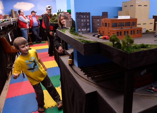 Aiden Wheeler, 8, watches a model train go around the bend in Ken Riediger's model railroad Saturday. Each year before Thanksgiving, Riediger invites the public to come see it.